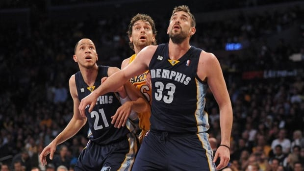 Marc Gasol, front, anchored a Memphis defence that allowed a league-best 88.7 points per game.