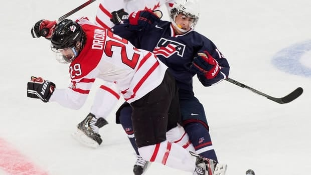 Canada forward Jonathan Drouin, left, takes out U.S. forward John Gaudreau, right, during the first period of their semifinal game Thursday.