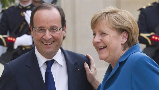 French President Francois Hollande, left, and German Chancellor Angela Merkel are attending an EU summit on Thursday to address the economic woes facing the eurozone.