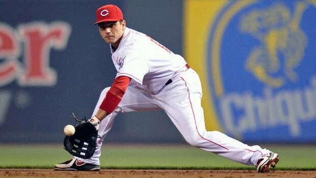 Joey Votto of the Cincinnati Reds fields a ground ball against the Los Angeles Dodgers on September 23, 2012 in Cincinnati, Ohio.