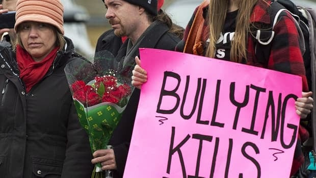 Leah Parsons (left), mother of Rehtaeh Parsons who committed suicide after months of bullying following an alleged sexual assault, and her partner Jason Barnes, attend a protest calling for action on bullying. Cases such as Rehtaeh's are prompting schools to look at anti-bullying apps to help students report harassment.