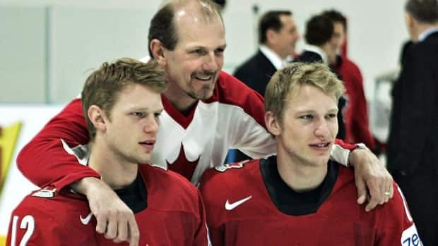 In this 2007 photo, Team Canada player Eric Staal, left, and brother Jordan, right, pose with their father Henry following the team picture at the IIHF World Hockey Championship in Moscow, Russia. The Staal family's backyard rink will be a part of Hockey Day in Canada celebrations, taking place across the nation on Saturday.