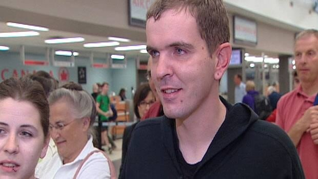 Andrew Dahlen waits at the Saskatoon airport early Monday morning to board a flight to Albany, N.Y., where he will take part in a clinical trial for the controversial 'liberation therapy' for multiple sclerosis.