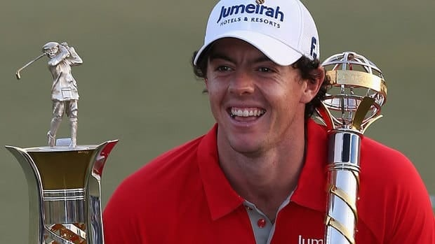 Rory McIlroy of Northern Ireland recorded four PGA Tour victories in 2012 and poses with the trophies following his win at the season-ending Dubai World Championship.