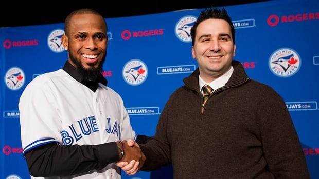 New Toronto Blue Jay shortstop Jose Reyes shakes hands with General Manager Alex Anthopoulos at a press conference in Toronto on Thursday January 17, 2013.