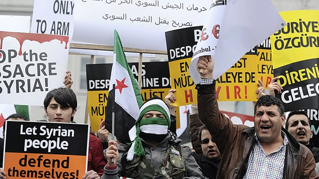 Demonstrators shout slogans against Syrian President Bashar al-Assad outside the Friends of Syria conference in Istanbul on Sunday.