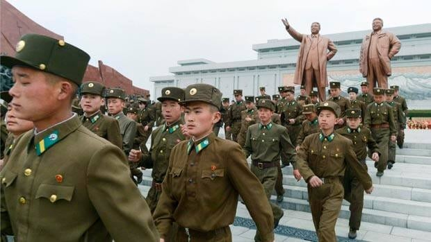 Soldiers visit the bronze statues of North Korea founder Kim Il-sung, left, and late leader Kim Jong-il in Pyongyang on the birthday of Kim Il-sung.