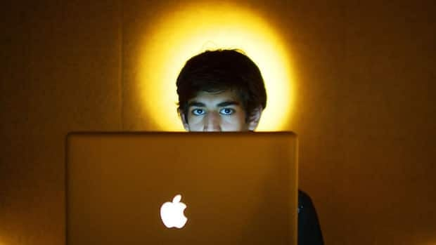 In this Jan. 30, 2009 photo, internet activist Aaron Swartz poses for a photo in Miami Beach, Fla.