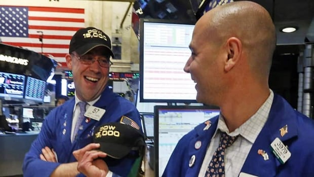 Stock traders broke out the cheers and commemorative 'DOW 15,000' baseball caps when the Dow hit the benchmark record high on Friday.