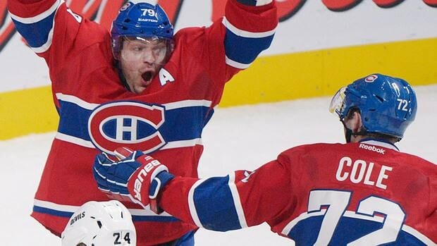 Montreal Canadiens defenceman Andrei Markov, left, celebrates with teamamate Erik Cole, right, after scoring the overtime winner against the New Jersey Devils in overtime on Sunday in Montreal.