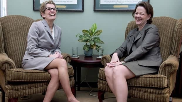 Alberta Premier Alison Redford meets with incoming Ontario Premier Kathleen Wynne (left) at the Ontario Legislature in Toronto on Wednesday January 30, 2013.
