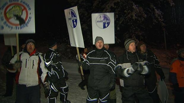Locked-out workers walked a picket line outside the Rio Tinto Alcan smelter in Alma, Quebec.