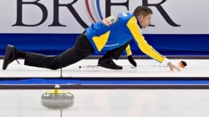 John Morris throws a rock for Team Alberta at the Brier in March, one of his last major competitions with longtime skip Kevin Martin.