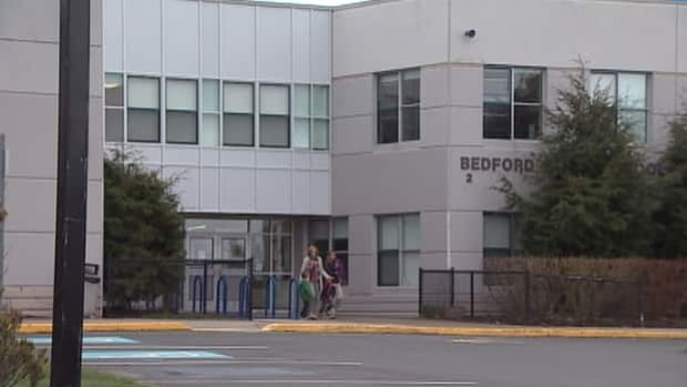 Parents at Bedford South School said they were shocked by the allegation against a school monitor.