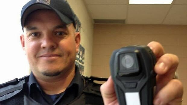 Amherstburg police Sgt. Scott Riddell shows off the new body camera he'll be wearing starting next week.