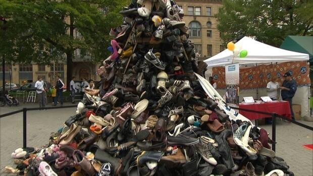 A pile of shoes in Montreal's Phillips Square represents the hundreds of thousands of people who have lost limbs due to landmines and cluster ammunition.