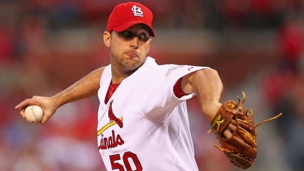 St. Louis Cardinals pitcher Adam Wainwright, a 14-game winner in his first year back from elbow reconstruction surgery, successfully fought against restricting his innings and starts Sunday in the NL division series opener.