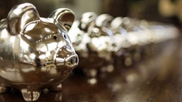 Canadians' net worth increased even as their debt loads ticked higher last year, a report suggested Thursday.