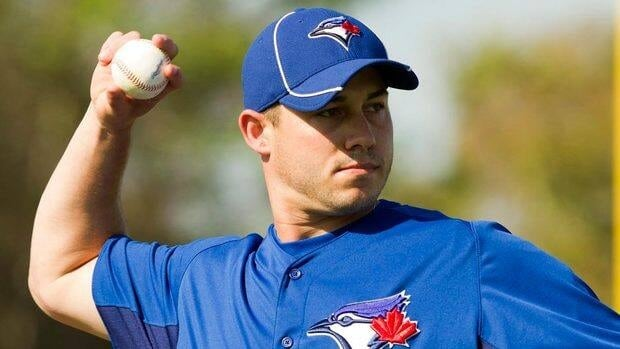 Toronto Blue Jays pitcher Dustin McGowan throws to first base at Jays Spring Training in Dunedin, Fla.