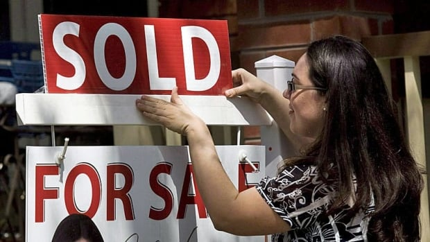 Canadian home prices inched higher in March, despite a large drop in the number of homes sold.