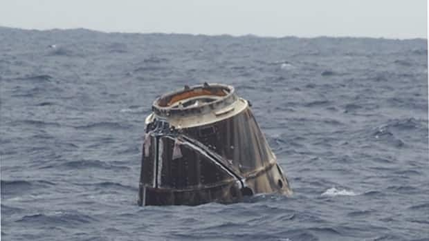 The SpaceX Dragon commercial cargo spacecraft floats in the Pacific Ocean after splashing down about 900 kilometres west of Baja California, Mexico. The capsule returned from the International Space Station on Thursday.