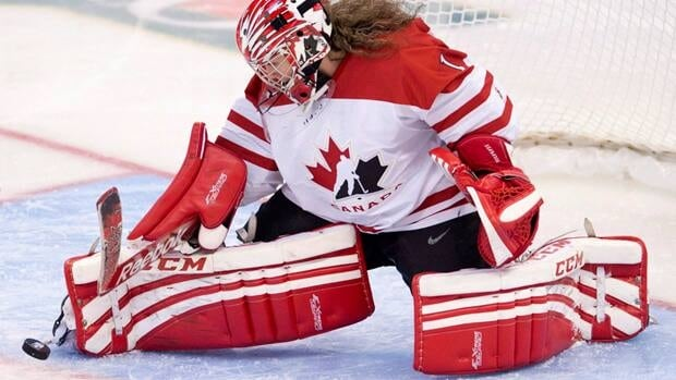 Shannon Szabados, seen here blocking a shot by Team Finland during the IIHF Womens World Ice Hockey championships, will play a full season with female hockey players as the Canadian women's team prepares for the 2014 Olympics.