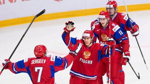 Russian forward Vladimir Tkachyov, centre, celebrates his game winning goal Friday against team USA at the 2013 IIHF World Junior Hockey Championship.