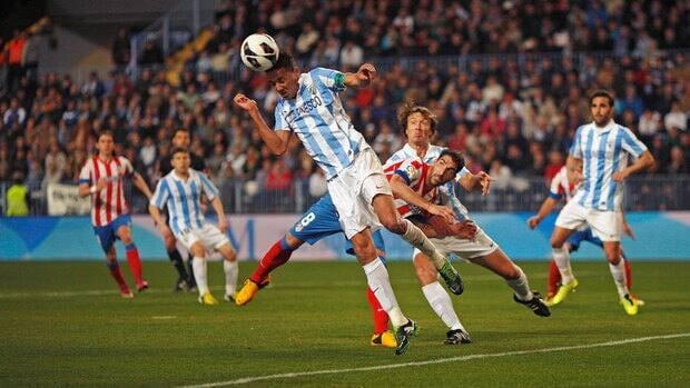 Malaga's Weligton Robson heads the ball during their match against Atletico Madrid on Sunday.