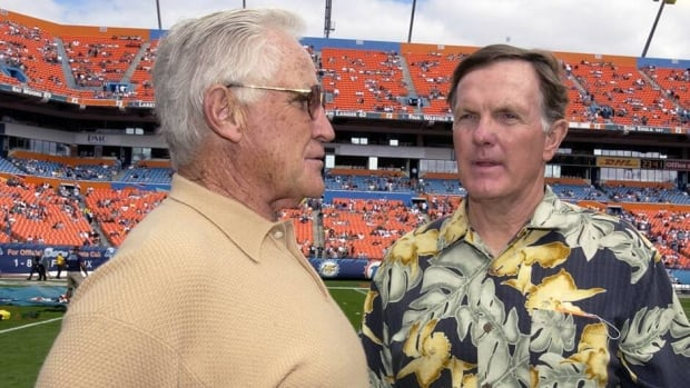 Former Miami Dolphins coach Don Shula talks with quarterback Bob Griese at Pro Player Stadium, Miami, Florida, December 28, 2003.