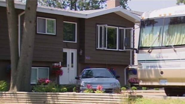 The girl was pulled from a pool behind this Surrey home Monday.