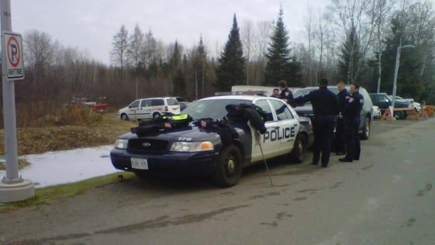 Police search the area near Thunder Bay Regional Health Sciences Centre.