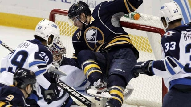 Sabres' Drew Stafford collides with Winnipeg Jets goalie Ondrej Pavelec in the late going of Buffalo's 6-5 overtime win back in early November. The Jets' franchise, going back to Atlanta days, has not had a lot of luck against Buffalo.