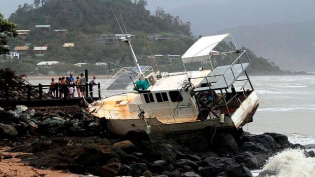The storm washed this boat on to rocks at Airlie Beach, 120 kilometres southeast of the city of Townsville in Queensland.
