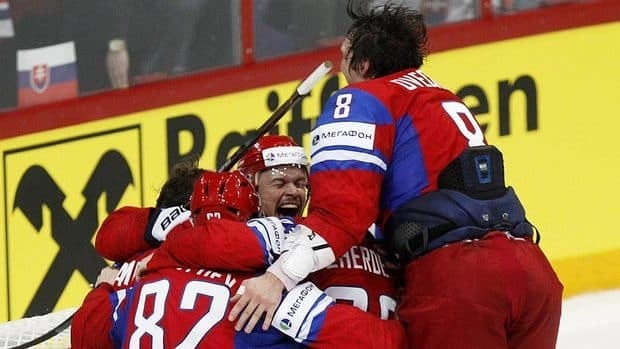 Russia team players celebrate their 6-2 victory over Slovakia in the final at the world hockey championship in Helsinki.