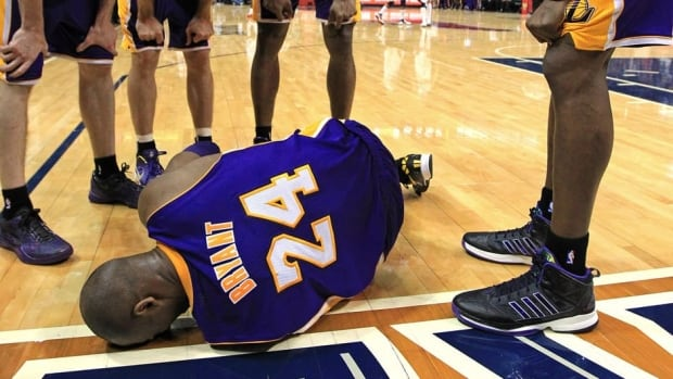 Los Angeles Lakers guard Kobe Bryant lays on the floor after being injured in the final seconds of a game against the Atlanta Hawks on Wednesday in Atlanta.