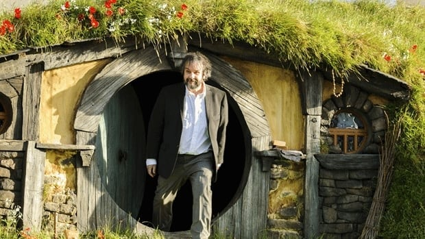 New Zealand director Peter Jackson emerges from a 'Hobbit Hole' in New Zealand.