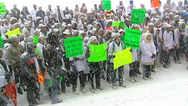Pharmacists from across Alberta braved the snow in Edmonton to protest changes to prescription drug costs in the province.