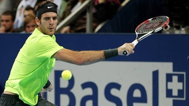 Argentinian Juan Martin Del Potro returns the ball to Roger Federer on Sunday during the final match of the Swiss Indoors ATP tennis tournament in Basel.