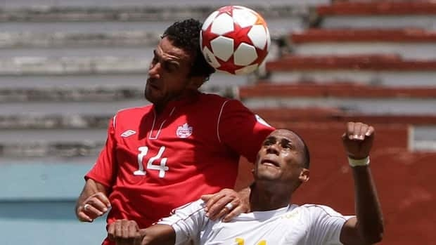 Canada's Dwayne De Rosario, left, will miss the remainder of the second round qualifying matches after suffering a sprained MCL on Tuesday.