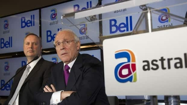 BCE president and CEO George Cope, left, and Ian Greenberg, president and CEO of Astral Media Inc., have been trying to merge their media companies for more than a year. On Thursday, the CRTC approved the $3.8-billion sale of Astral to BCE, creating a media behemoth that some say will restrict competition in Canada's TV and radio broadcasting market.