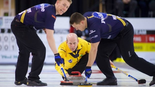 Kevin Martin, bottom, delivers a stone on the opening day of the National.