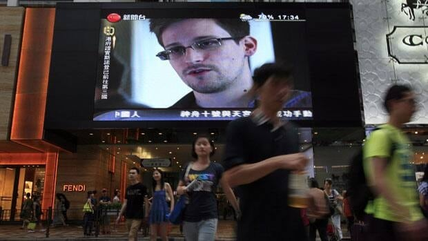 Image of Edward Snowden, a former CIA employee who leaked top-secret documents about sweeping U.S. surveillance programs, shown on a TV screen at a shopping mall in Hong Kong. The former National Security Agency contractor has been on the run since leaving Hong Kong last weekend and flying to Russia.