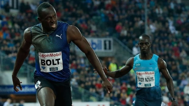Usain Bolt, left, crosses the finish line in 19.79 seconds in the men's 200 metres on Thursday in Oslo, Norway, the fastest long sprint run by anyone this season.