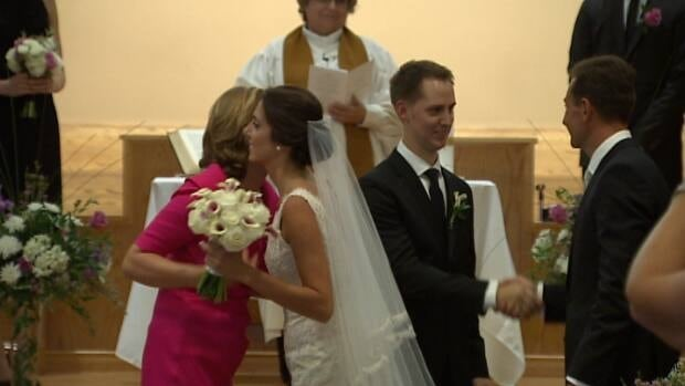 Premier Robert Ghiz and his mother gave the bride away.