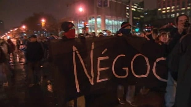 Students march through a rainy downtown Montreal Thursday night.