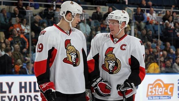 Daniel Alfredsson of the Ottawa Senators talks with teammate Jason Spezza during a timeout.