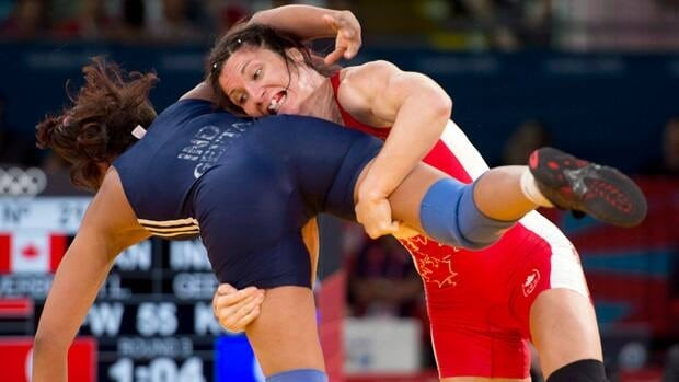 In this file photo from Aug. 9, 2012, Canada's Tonya Verbeek lifts India's Geeta Geeta in their 55kg freestyle wrestling match at the 2012 Summer Olympics  in London.