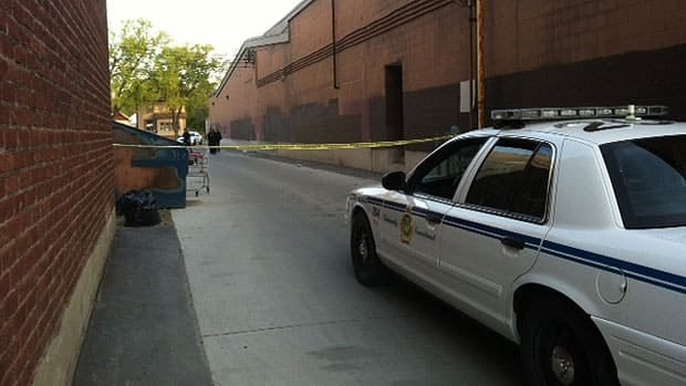 Police investigate the scene of an assault in Winnipeg's West End on Thursday.