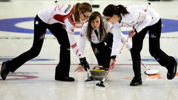 Team Canada skip Rachel Homan, middle, plays a shot in Monday's 5-4 win over Russia.