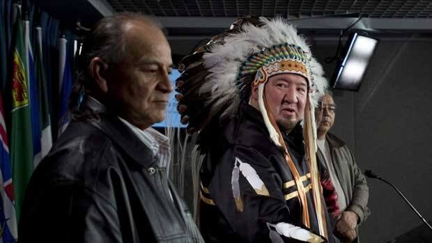 Grand Chief Murray Clearsky, left, of the Southern Chiefs' Organization stands with Grand Chief Derek Nepinak of the Assembly of Manitoba Chiefs as they speak to media Jan. 18 in Ottawa.